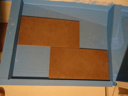 Gepuzzel om zoveel mogelijk hele tegels op de 3 vlakken te krijgen